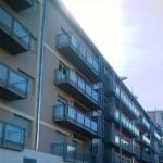Parapetti per balconi con struttura in ferro e vetro