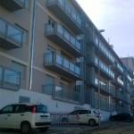 Parapetti per balconi in ferro e vetro e brise soleil in alluminio